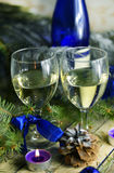 Christmas drinks in glasses on a background of festive decorations in blue colors Stock Photo