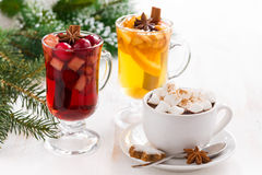 Christmas drinks - hot chocolate with marshmallows, mulled wine Royalty Free Stock Images