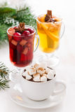 Christmas drinks - hot chocolate with marshmallows, mulled wine Royalty Free Stock Photo