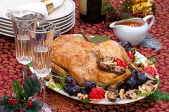 Christmas duck on holiday table Stock Photos