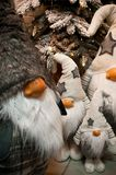 Christmas dwarves plush toys under Xmas tree Stock Photo