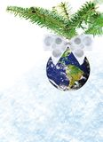 Christmas earth snow. Christmas decoration of planet earth with white bow on christmas tree on snow background stock photo