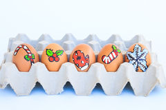 Christmas egg with faces drawn arranged in carton Stock Photo