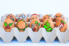 Christmas egg with faces drawn arranged in carton Stock Images