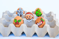 Christmas egg with faces drawn arranged in carton Stock Photos