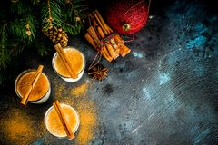Christmas eggnog liqueur. Drink or cola de mono cocktail. traditional winter cocktail in short glasses, with xmas decorations, dark background copy space stock photo
