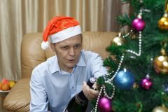 Christmas elderly man, champagne royalty free stock image