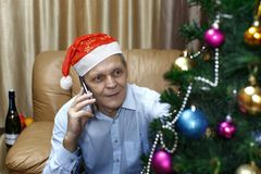 Christmas elderly man, phone stock images