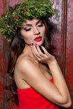 Christmas elegant fashion woman. Xmas New Year hairstyle and makeup. Gorgeous Vogue style Lady with Christmas decorations on her Royalty Free Stock Image