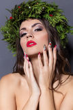 Christmas elegant fashion woman. Xmas New Year hairstyle and makeup. Gorgeous Vogue style Lady with Christmas decorations on her Stock Image