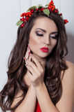 Christmas elegant fashion woman. Xmas New Year hairstyle and makeup. Gorgeous Vogue style Lady with Christmas decorations on her Royalty Free Stock Photo