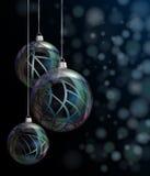 Christmas elegant glass baubles. Elegant glass Christmas baubles against bokeh background Royalty Free Stock Images