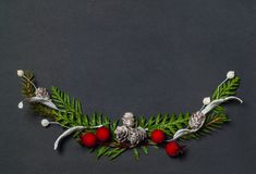 Christmas elegant wreath on black background, top view stock images