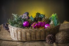 Christmas element in basket on dark background.  royalty free stock image