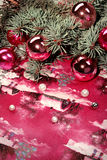 Christmas elements. Twig with red balls and beads Stock Image