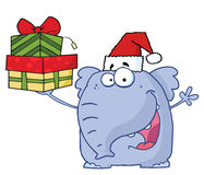 Christmas elephant holds up gifts Stock Image