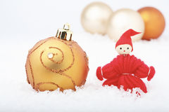 Christmas elf and baubles. Royalty Free Stock Images