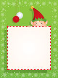 Christmas elf behind a blank banner Stock Image