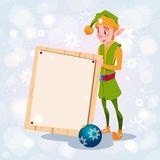 Christmas Elf Boy Cartoon Character Santa Helper Hold Empty Sign Board Banner. Flat Vector Illustration Royalty Free Stock Photos
