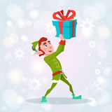 Christmas Elf Boy Cartoon Character Santa Helper With Present Box Royalty Free Stock Photo