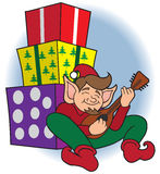 Christmas Elf on Break. Christmas elf is taking a break and doing a little strumming Royalty Free Stock Image