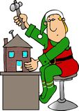 Christmas Elf building a Doll House Stock Photography