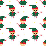 Christmas elf with candy cane seamless pattern on white background. Stock Images