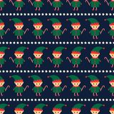 Christmas elf with candy cane and xmas stars seamless pattern on dark blue background. Cute winter holidays background. Baby design for textile, fabric, decor Stock Photography