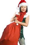 Christmas Elf Carrying Gifts Stock Images