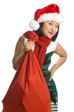 Christmas Elf Carrying Gifts Stock Image