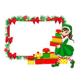 Christmas elf with empty frame Stock Images