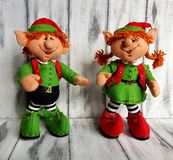 Christmas elf felt decoration on a spruce branch. Handmade bauble figurines elves. Holiday background with a copy space.
