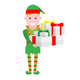 Christmas elf with gift boxes Stock Images