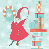 Christmas Elf and Gifts Royalty Free Stock Image