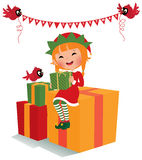 Christmas elf with gifts Royalty Free Stock Photo