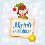 Christmas Elf Girl Cartoon Character Santa Helper Hold Sign Board Merry Christmas Banner. Flat Vector Illustration Royalty Free Stock Photos