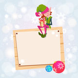 Christmas Elf Girl Cartoon Character Santa Helper Sit On Empty Sign Board Banner. Flat Vector Illustration Royalty Free Stock Photo
