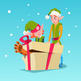 Christmas Elf Group Cartoon Character Santa Helper With Big Present Box Royalty Free Stock Photo