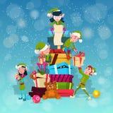Christmas Elf Group Cartoon Character Santa Helper With Present Box Stack Stock Image