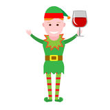 Christmas elf holding a glass of wine Royalty Free Stock Image