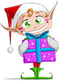 Christmas Elf Holding A Present Stock Image