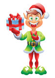 Christmas elf holding present Stock Photos