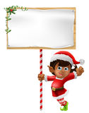 Christmas elf holding a sign. Cartoon woman or girl Christmas elf in Santa Christmas hat holding a sign Royalty Free Stock Photography