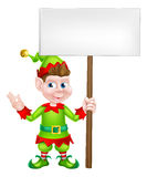 Christmas Elf Holding Sign. Christmas Elf or one of Santa s Christmas helpers holding a sign Royalty Free Stock Images