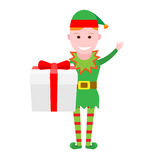 Christmas elf holds a gift box Royalty Free Stock Photo