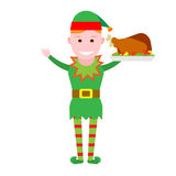 Christmas elf holds a plate with a christmas turke Royalty Free Stock Photos