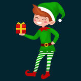 Christmas elf isolated with gifts in box in a green suit with, assistant of Santa Claus, boy helper holding gifts for Stock Images