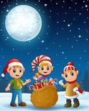 Christmas elf kids present a sack full of gifts Stock Image