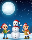 Christmas elf kids present a sack full of gifts Stock Photo