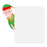 Christmas elf looks out of behind the wall Stock Photos